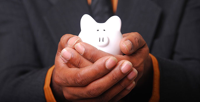 piggy bank in hands