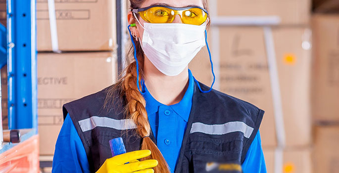 woman wearing personal protective gear