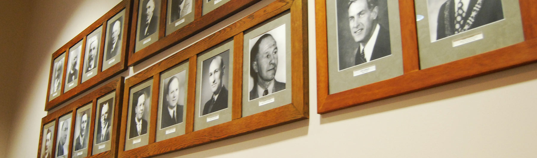 image of past mayors in frames on a wall in council chambers