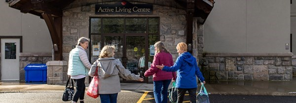four women walking toward the Active Living Centre