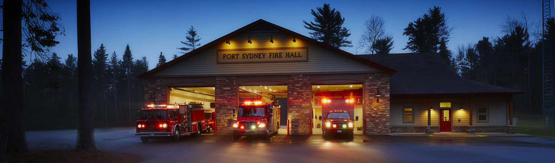 port sydney fire department station at night with three fire trucks