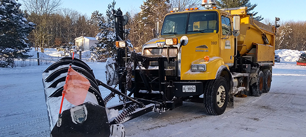 photo of plow truck in winter