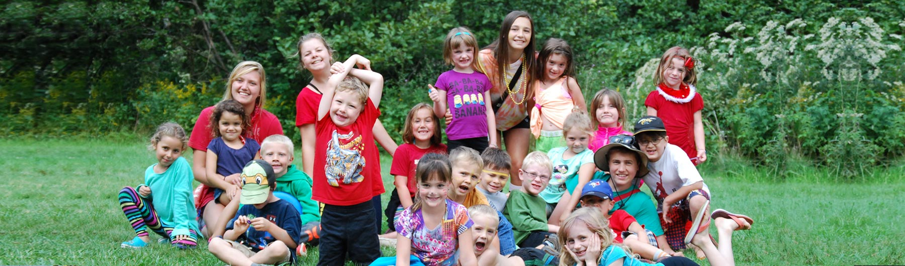 Summer Camp kids in a group smiling and goofing around