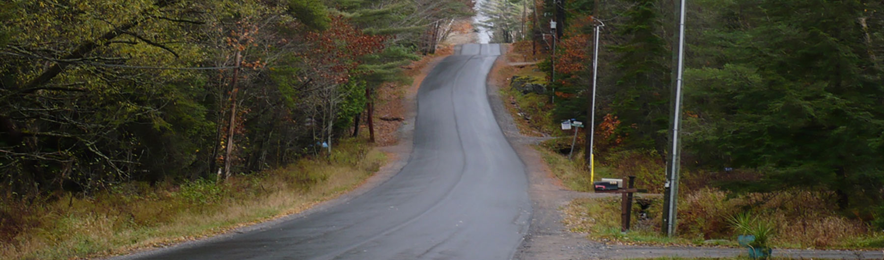 paved road going up a hill
